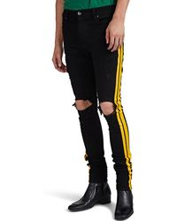 Amiri Track Distressed Striped Skinny Jeans - Yellow