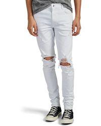 Amiri Thrasher Distressed Skinny Jeans - White