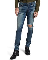 Amiri Broken Distressed Skinny Jeans - Blue