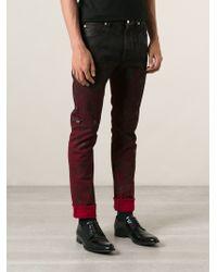 Versace Waxed Denim Medusa Trousers - Lyst