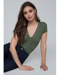 Bebe - Studded Knit Bodysuit - Lyst