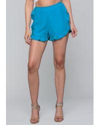 Bebe - Ruffled Dolphin Shorts - Lyst
