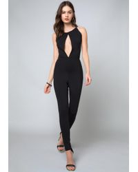 6ad5e7535e97 Lyst - Bebe Off Shoulder Catsuit in Black