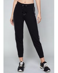 Bebe - Logo Lace Trim Jogger Trousers - Lyst