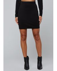 Bebe - Mesh Inset Ponte Miniskirt - Lyst