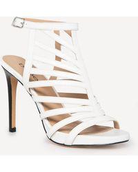 5de5ea88af4 Lyst - Bebe Delja Jeweled Sandals in Metallic