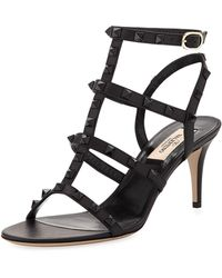 e1f69b68cc6 Lyst - Valentino Rockstud Patent Leather Cage Sandals in Natural