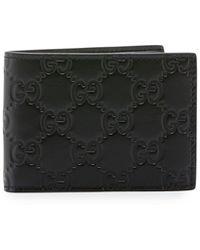 Gucci - Signature Leather Bi-fold Wallet - Lyst