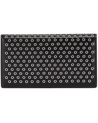 Alaïa Grommet Leather Flap Wallet - Black