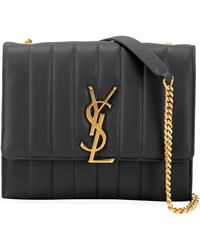 37eac3d08be Saint Laurent Monogram Ysl Matelasse Zip-around Wallet in Black - Lyst