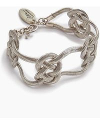 Lena Bernard Sabha Knotted Silver Fishtail Chain Bangle Bracelet - Metallic