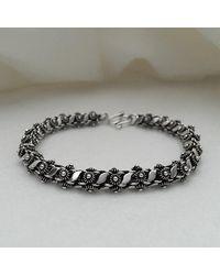 Blanc de Noir & Co. Classic Phikoun Rope Bracelet W/ Leaf Accent - Metallic