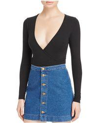 American Apparel - Deep V Jersey Bodysuit - Lyst