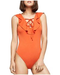 BCBGeneration - Ruffled Lace-up Bodysuit - Lyst