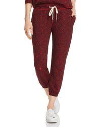 n:PHILANTHROPY Derby Cheetah - Print Jogger Trousers - Red