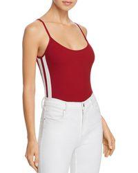 Honey Punch - Track Stripe Rib-knit Bodysuit - Lyst
