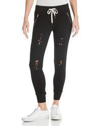 n:PHILANTHROPY N Philanthropy Gravity Distressed Jogger Trousers - Black