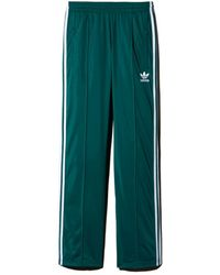 adidas Originals Synthetic Firebird Tape Track Pants in