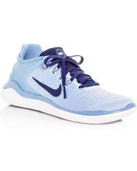 e0b05038b374 Lyst - Nike Women s Free Rn Flyknit Lace Up Sneakers in Blue