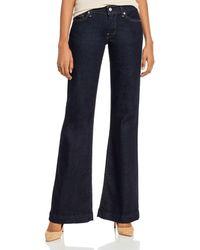 7 For All Mankind Reissue Dojo Low - Rise Flared Jeans In Mercer - Blue