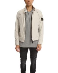 92338ce37 Windbreaker Jacket - Natural ... Info Stone Island's beige Windbreaker  jacket boasts year-round appeal. Designed to tackle wind and rain, this  crepe ...