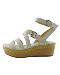 8d506ee0a72 Lyst - Michael michael kors Jalita Charm Leather Wedge Sandal in ...