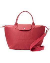 9e59791bb230 Lyst - Longchamp Le Pliage Neo Medium Nylon Shoulder Tote Bag in Pink