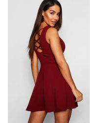 cc4b91a36d Boohoo Scuba Strappy Pleated Skater Dress in Red - Lyst