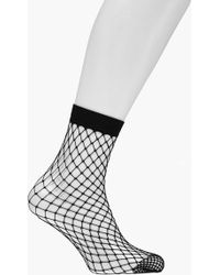 6dd2a0e339ae6 Boohoo Sports Stripe Mock Hold Up Fishnet Tights in Black - Lyst