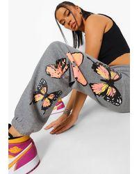 Boohoo Pantalones De Deporte Con Estampado De Mariposas - Gris