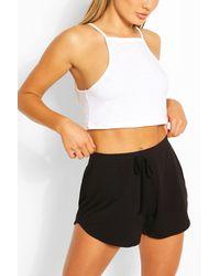 Boohoo Pantalones Cortos De Correr Básicos Con Bajo Curvo - Morado