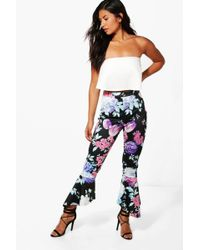 Boohoo - Lucinda Bright Floral Dipped Hem Skinny Trousers - Lyst