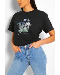 Boohoo T-shirt con stampa floreale e slogan - Nero