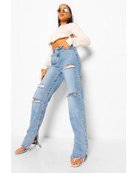 Boohoo Jeans effetto consumato con spacco all'orlo - Blu