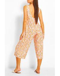 Boohoo Mono Largo Estilo Culottes Con Escote Redondo Por Detrás Y Estampado Floral - Naranja