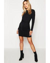 5e9df7d518b9 Lyst - Boohoo Rib Knit Button Front Bardot Dress in Black
