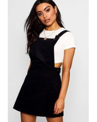 Lyst - Boohoo Riva Embroidered Denim Pinafore Dress in Black 04d034cee