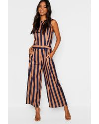 a08a84a27 Boohoo Steph Halter Neck Plunge Neck Jumpsuit in Blue - Lyst