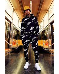 Boohoo - Trainingsanzug mit Kapuze und durchgehendem MAN-Print - Lyst