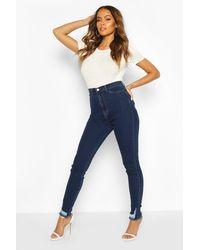 Boohoo - Jeans skinny elasticizzati con orlo sfilacciato - Lyst