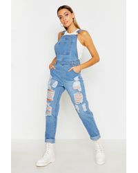 0a0755281bbc7 Boohoo Nia Distressed Ripped White Denim Dungarees in White - Lyst