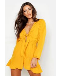 Boohoo Womens Knot Front Ruffle Hem Playsuit - Gelb