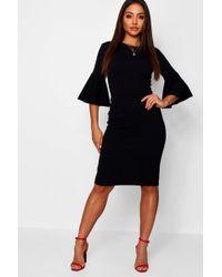 14d066533c351 Lyst - Boohoo Angel Sleeve Twist Front Velvet Shift Dress in Black