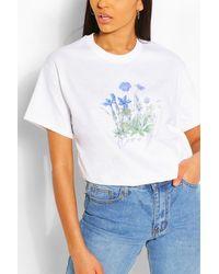 Boohoo T-shirt con stampa floreale e slogan - Bianco