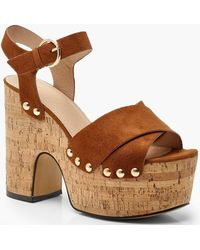 7afe2e3f265d Lyst - River Island Gold Gladiator Wedges in Metallic