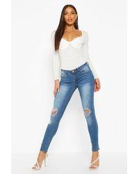 Boohoo Womens Skinny-Jeans In Distressed-Optik Mit Rissen Am Knie - Blau