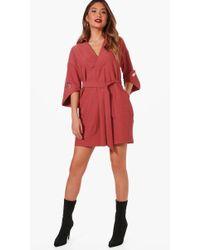 d473e082fe7e Boohoo Belted Asymmetric Collar Shirt Dress in Red - Lyst