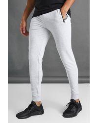 BoohooMAN Joggings de sport skinny à poches zippées - Gris