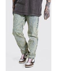 BoohooMAN Lockere Jeans mit Acid Waschung - Gelb