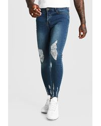 BoohooMAN Indigo Super Skinny Jeans With Raw Hem - Blue